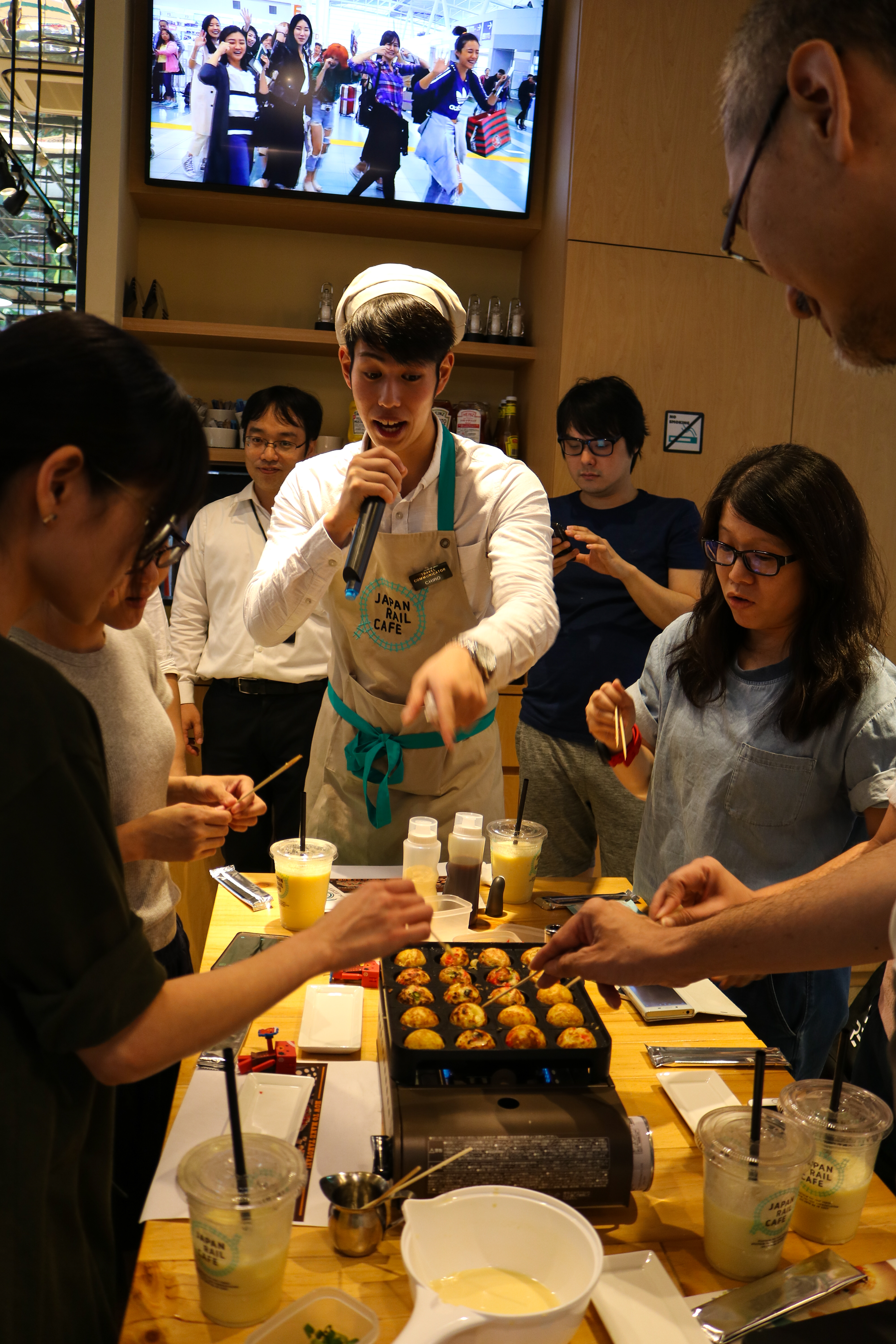 "Travel Communicator Chiro complimenting on participants' freshly made takoyaki: ""That's the most perfect takoyaki balls I've ever seen."" Good job, everyone!"
